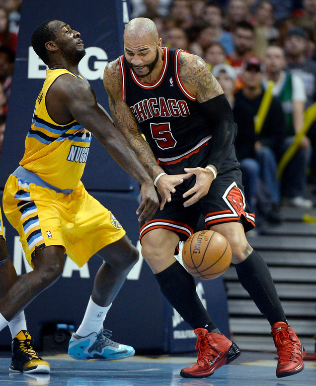 . Chicago Bulls power forward Carlos Boozer (5) gets the ball knocked away by Denver Nuggets power forward J.J. Hickson (7) during the first quarter November 21, 2013 at Pepsi Center. (Photo by John Leyba/The Denver Post)