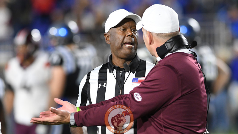 Head official Ron Cherry explains the decision to Virginia Tech head coach Justin Fuente. (Michael Shroyer/TheKeyPlay.com)