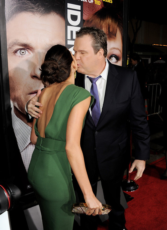 ". Actress Genesis Rodriguez (L) and actor Eric Stonestreet arrive at the premiere of Universal Pictures\' ""Identity Theft\"" at the Village Theatre on February 4, 2013 in Los Angeles, California.  (Photo by Kevin Winter/Getty Images)"