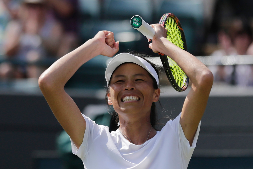 . Su-Wei Hsieh of Taiwan celebrates defeating Simona Halep of Romania in their women\'s singles match on the sixth day at the Wimbledon Tennis Championships in London, Saturday July 7, 2018. (AP Photo/Ben Curtis)