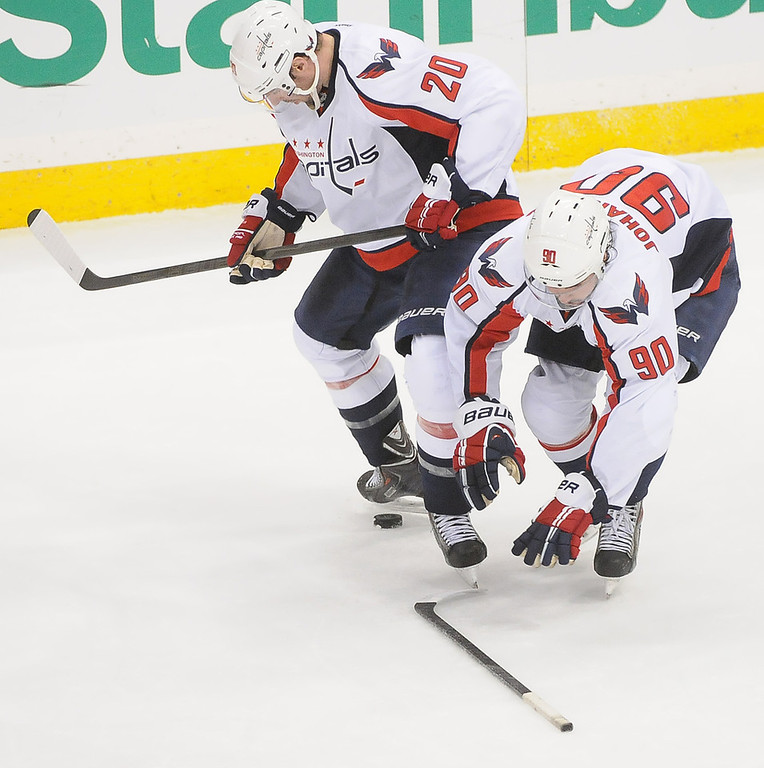 . Washington Capitals Troy Brouwer looks for the puck and teammate  Marcus Johansson grabs his stick during the second period.(Pioneer Press: Sherri LaRose-Chiglo)