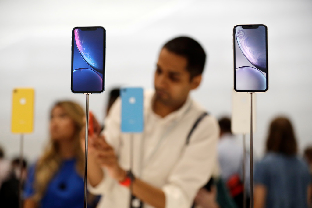 . The new iPhone XR is displayed at Apple headquarters during an event to announce new products Wednesday, Sept. 12, 2018, in Cupertino, Calif. (AP Photo/Marcio Jose Sanchez)