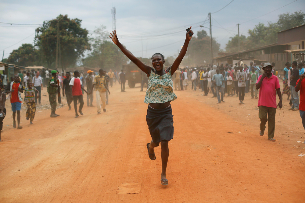 . Christian residents jubilate as Seleka Muslim militias evacuate the Kasai camp in Bangui, Central African Republic, Tuesday, Jan. 28, 2014, to relocate and join other Selekas at the PK11 camp. The departure of the fighters was greeted with screams of joy from the crowd of hundreds that gathered to watch them leave for another camp in northern Bangui. �We are free! This is our new year!� they shouted. Seleka became deeply unpopular after they killed and tortured civilians after seizing power in March 2013. Their leader Michel Djotodia stepped down as president earlier this month and went into exile in Benin. (AP Photo/Jerome Delay)