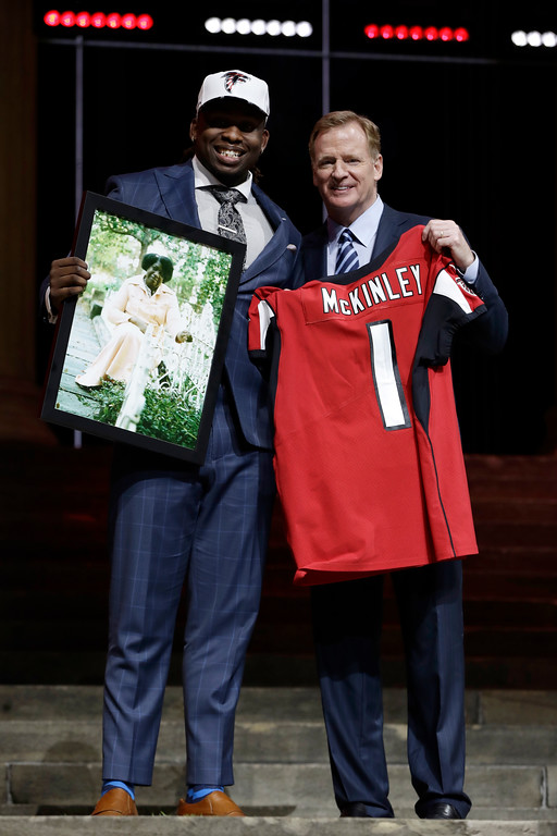 . UCLA\'s Takkarist McKinley, left, poses with NFL commissioner Roger Goodell after being selected by the Atlanta Falcons during the first round of the 2017 NFL football draft, Thursday, April 27, 2017, in Philadelphia. (AP Photo/Matt Rourke)
