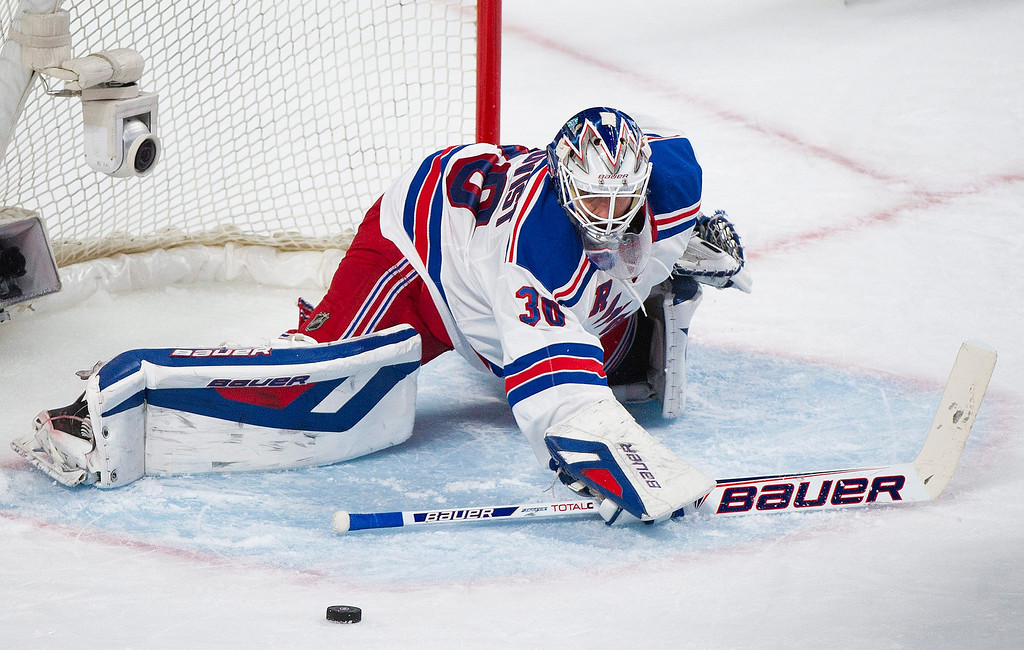 . New York Rangers\' goaltender Henrik Lundqvist makes a save against the Montreal Canadiens during the second period in Game 2 of the NHL hockey Eastern Conference final Stanley Cup playoff game in Montreal, Monday, May 19, 2014. (AP Photo/The Canadian Press, Graham Hughes)