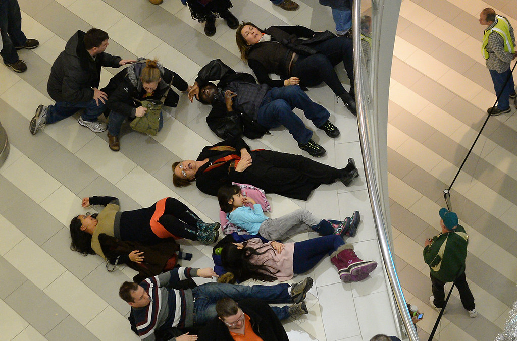 . People not with the larger demonstration on the first level of the rotunda  participated in the lie-down. (Pioneer Press: John Autey)