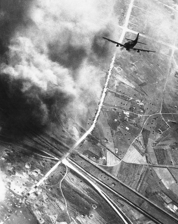 . A navy Skyraider plane from the carrier Prince ton piloted by Lieut. Donald Sparks of Alameda, Calif., starts a dive-bombing run on a target during a navy air attack on Kowon, 22 miles northwest of Wonsan on the Northeast coast of Korea, Oct. 20, 1950 and the main railroad line to Hamhung to the north. (AP Photo)