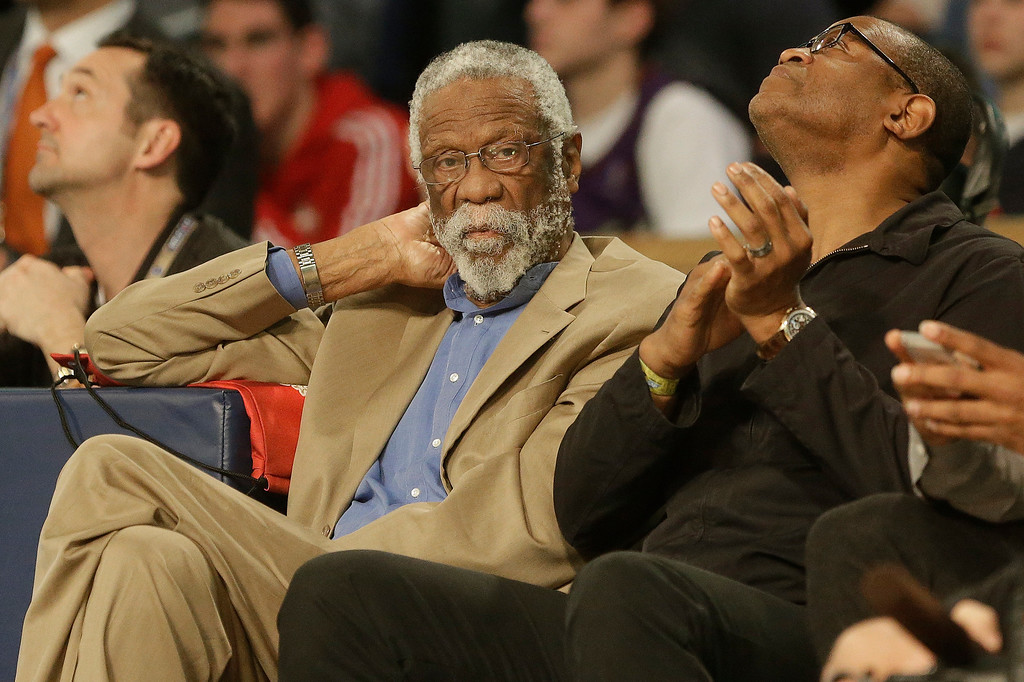 . Former NBA player Bill Russell watches play during the skills competition at the NBA All Star basketball game, Saturday, Feb. 15, 2014, in New Orleans. (AP Photo/Gerald Herbert)