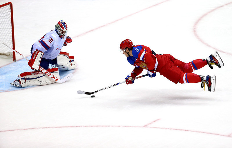 . Alexander Ovechkin #8 of Russia falls to the ice against Lars Haugen #30 of Norway during the Men\'s Ice Hockey Qualification Playoff game on day eleven of the Sochi 2014 Winter Olympics at Bolshoy Ice Dome on February 18, 2014 in Sochi, Russia.  (Photo by Streeter Lecka/Getty Images)