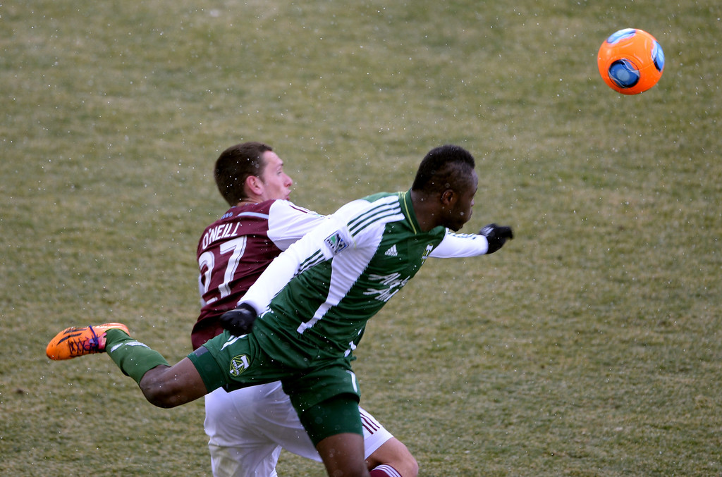. COMMERCE CITY MARCH 22: Shane O\'Neill of Colorado Rapids (27), left, and Steve Zakuani of Portland Timbers (7) are in action in the 2nd half of the game at Dick\'s Sporting Goods Park. Commerce City, Colorado. March 22. 2014. Colorado won 2-0. (Photo by Hyoung Chang/The Denver Post)