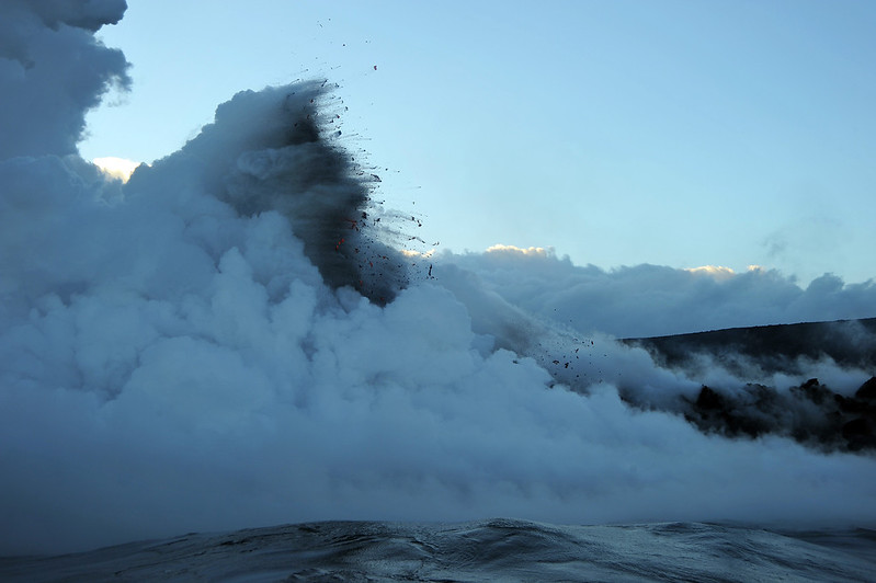 Lava explosion over boiling ocean on the south coast of Big Island, Hawaii