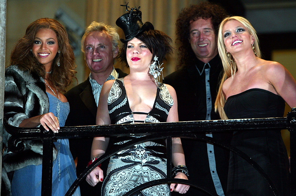 . Beyonce Knowles, Pink, and Britney Spears, foreground left to right, appear with Roger Taylor and Brian May of Queen, background left and right, at the premiere of Pepsi\'s new television commercial in Trafalgar Square, London, Monday, Jan. 26, 2004. (AP Photo/John D McHugh)