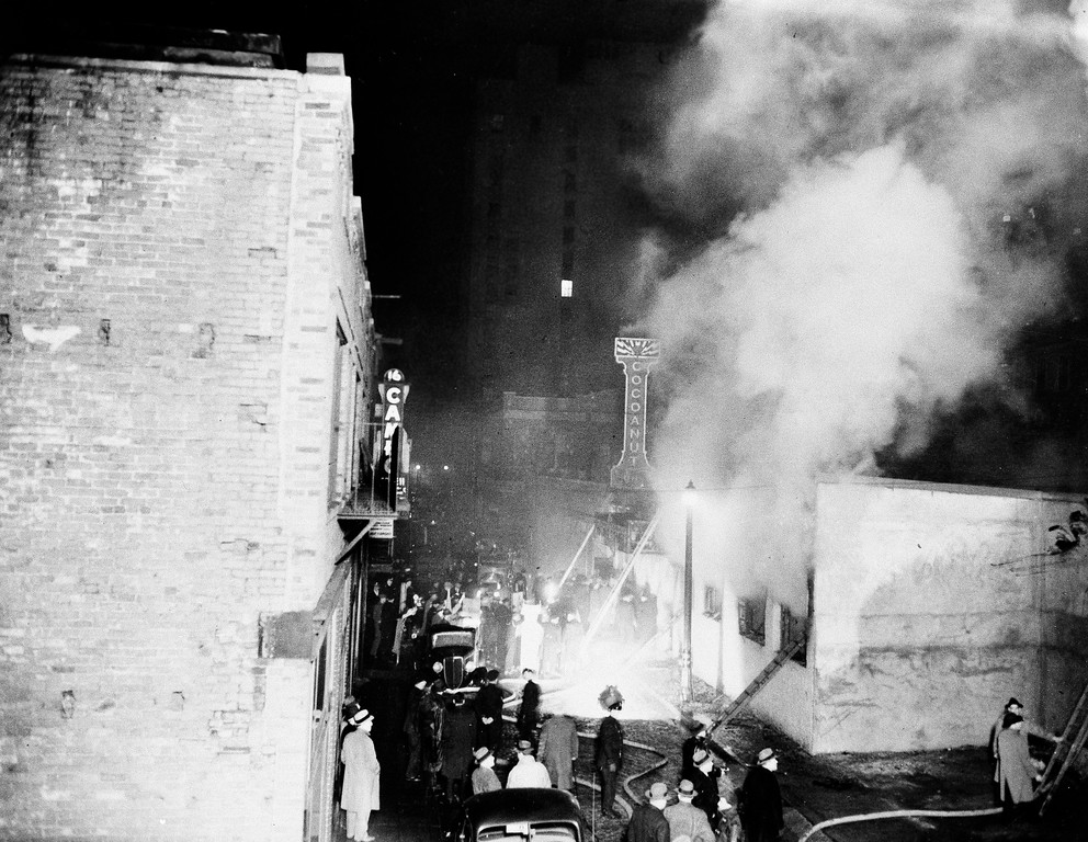 . Smoke pours from the Cocoanut Grove night club, right, during the fire of Nov. 28, 1942 in the Back Bay section of Boston.  Four hundred ninety two people died in the fire.  (AP Photo)