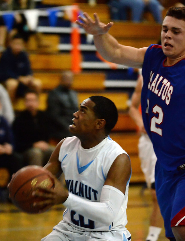 . Walnut\'s Lawrence Besong (C) (20) drives to the basket against Los Altos in the second half of a prep basketball game at Walnut High School in Walnut, Calif., on Wednesday, Jan. 22, 2014. (Keith Birmingham Pasadena Star-News)