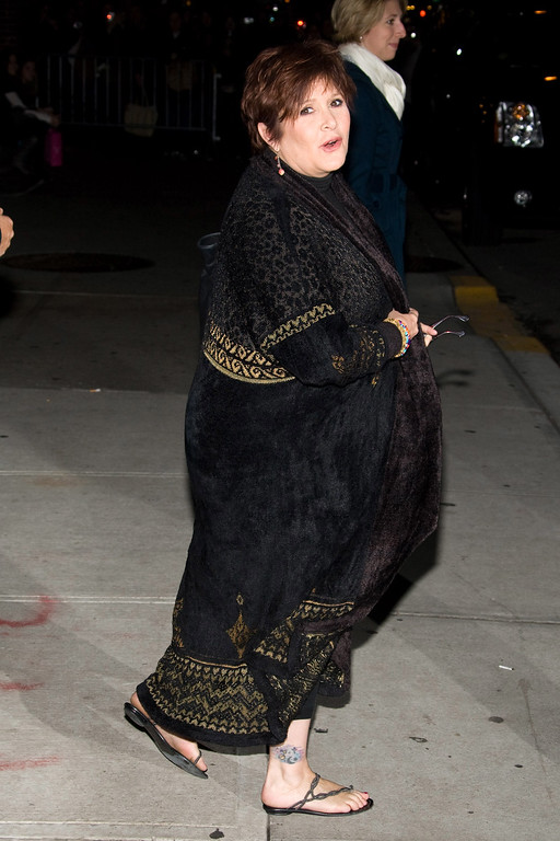 """. Carrie Fisher leaves a taping of \""""The Late Show with David Letterman\"""" in New York, Tuesday, November 24, 2009. (AP Photo/Charles Sykes)"""