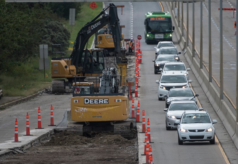 Traffic passes by excavators working alongside Groat Road in Edmonton on Monday August 27,2018 (photo by John Lucas/for Edmonton Journal)