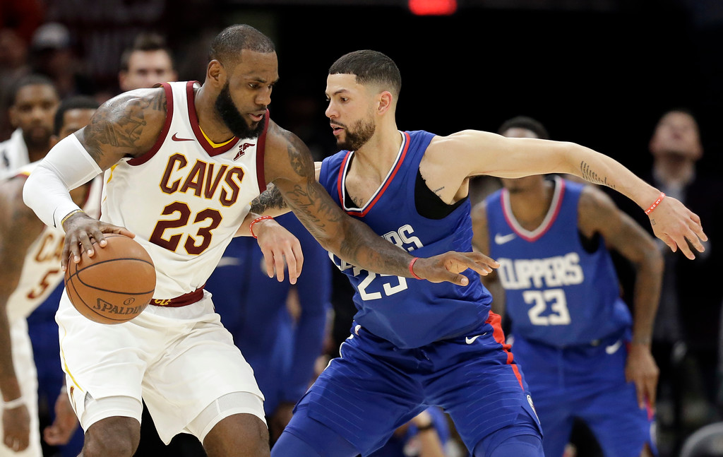 . Cleveland Cavaliers\' LeBron James (23) works against Los Angeles Clippers\' Austin Rivers (25) during the second half of an NBA basketball game, Friday, Nov. 17, 2017, in Cleveland. The Cavaliers won 118-113 in overtime. (AP Photo/Tony Dejak)