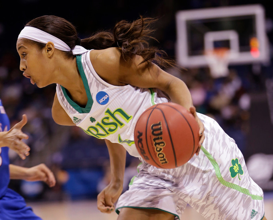 . Notre Dame guard Skylar Diggins (4) drives to the basket  during the second half of a regional semi-final of an NCAA college basketball tournament  Sunday, March 31, 2013 in Norfolk, Va.  Notre Dame won the game 93-63. (AP Photo/Steve Helber)