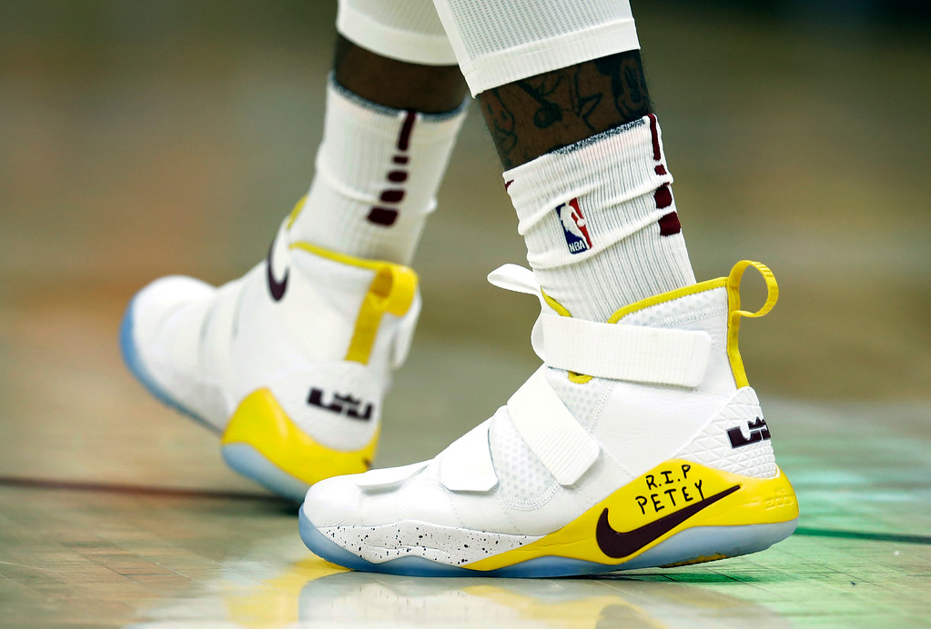 ". Cleveland Cavaliers\' JR Smith\'s shoes have "" RIP Petey\"" written on them in the first half of an NBA basketball game against the Miami Heat, Tuesday, Nov. 28, 2017, in Cleveland. Smith wrote on his shoes in honor of his cousin who died in a fire on Sunday. (AP Photo/Tony Dejak)"
