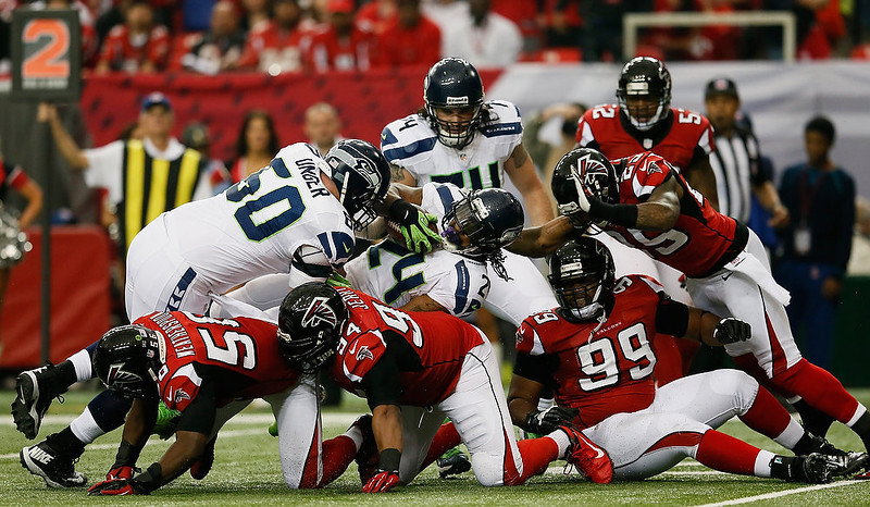 . Marshawn Lynch #24 of the Seattle Seahawks runs the ball against the Atlanta Falcons in the second quarter during the NFC Divisional Playoff Game at Georgia Dome on January 13, 2013 in Atlanta, Georgia.  (Photo by Kevin C. Cox/Getty Images)