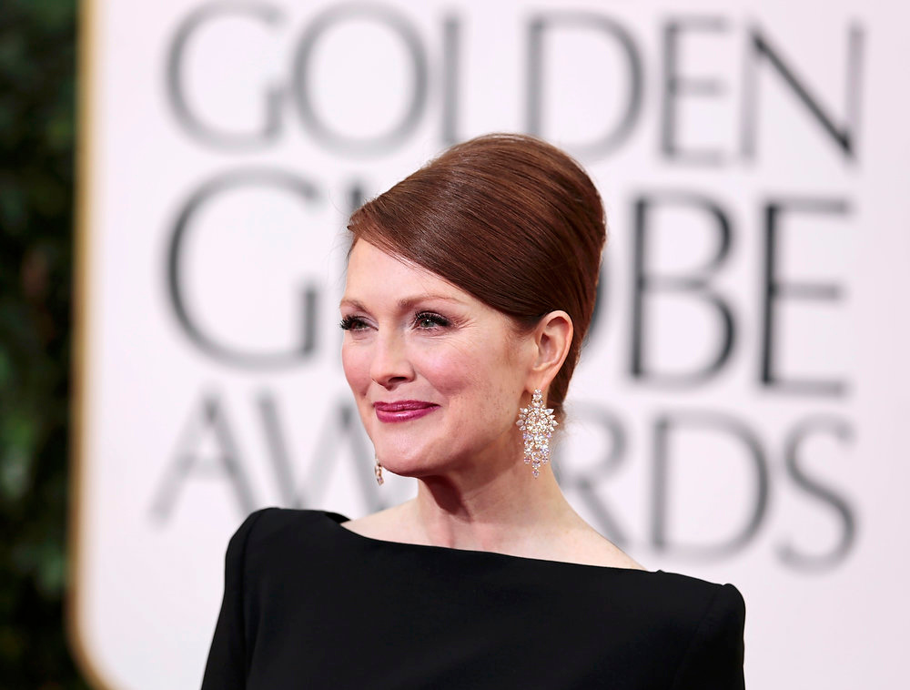 ". Actress Julianne Moore of the TV movie ""Game Change\"" at the 70th annual Golden Globe Awards in Beverly Hills, California January 13, 2013. REUTERS/Jason Redmond"