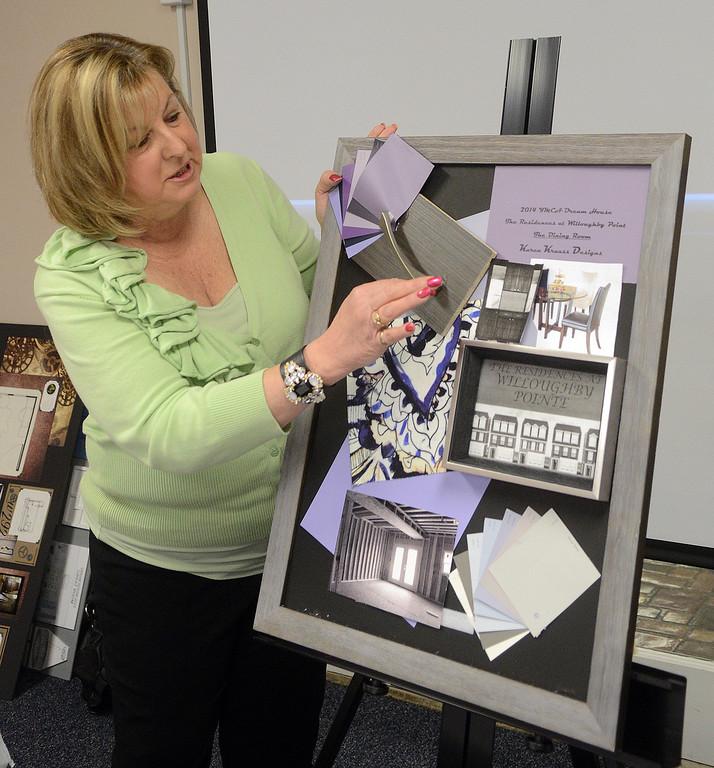 . Duncan Scott/DScott@News-Herald.com Karen Krauss presents her design for the dining room of the 2014 Lake County Dream House.