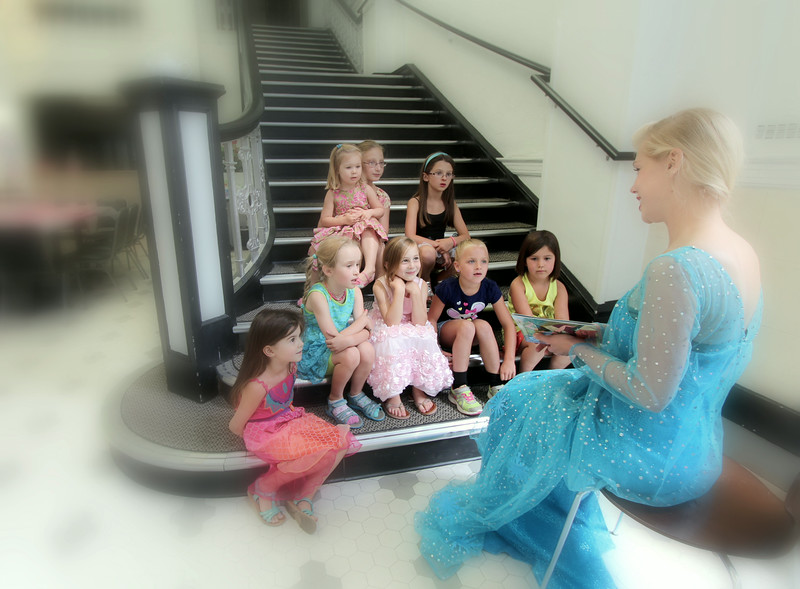 The Princess reads to the young ladies…..