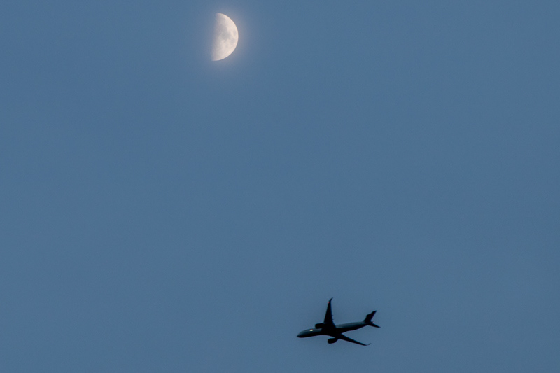 November 15 - An airplane, a half moon and the sky.jpg
