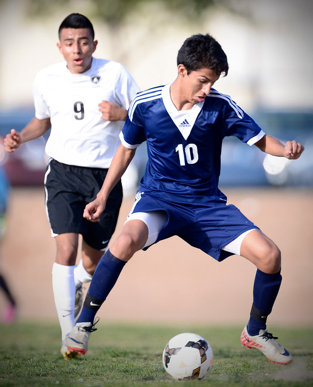 . Baldwin Park\'s Jesus Granados (10) controls the ball as Northview\'s Christian Palacios (9) approaches as Baldwin Park defeats Northview 2-0 during Tuesday\'s game at Northview High School, February 11, 2014. (Photo by Sarah Reingewirtz/Pasadena Star-News)