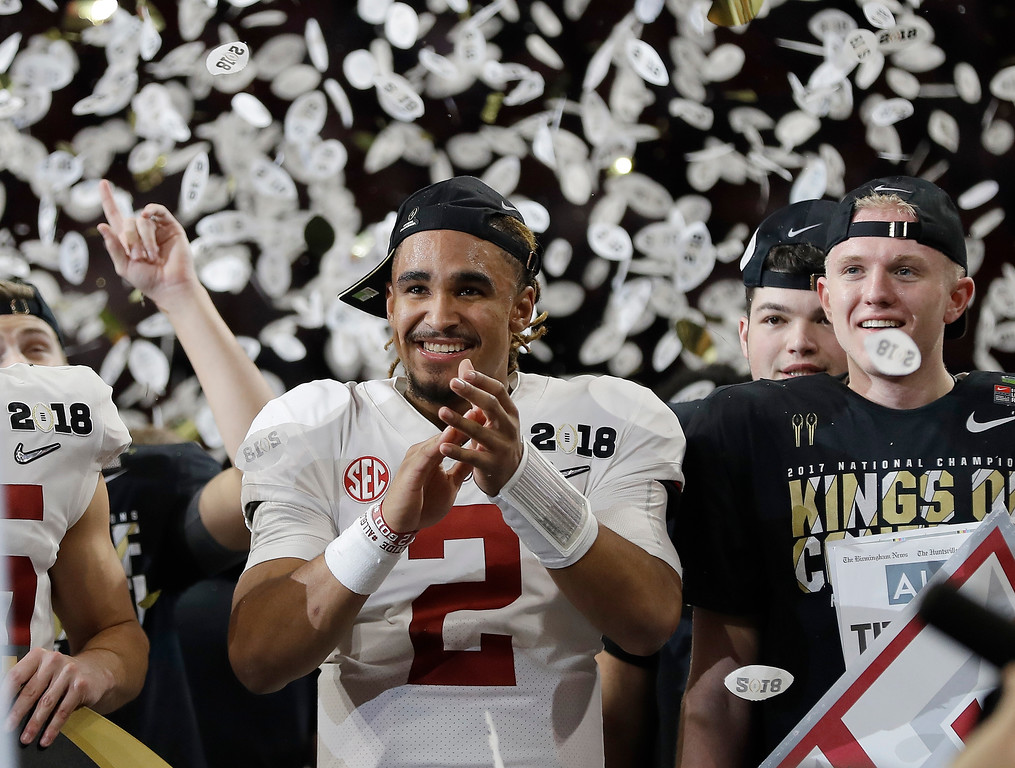 . Alabama\'s Jalen Hurts celebrates after overtime of the NCAA college football playoff championship game against Georgia, Monday, Jan. 8, 2018, in Atlanta. Alabama won 26-23. (AP Photo/David J. Phillip)