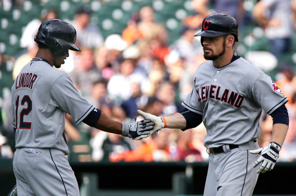 . Cleveland Indians\' Brandon Moss, right, is congratulated by Francisco Lindor (12) after hitting a solo home run against the Detroit Tigers during the ninth inning of a baseball game Sunday, June 14, 2015, in Detroit. (AP Photo/Duane Burleson)