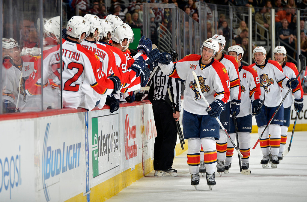 . Florida Panthers center Jonathan Huberdeau (11) celebrates a goal with teammates on the bench against the Colorado Avalanche during the third period of an NHL hockey game on Saturday, Nov. 16, 2013, in Denver. (AP Photo/Jack Dempsey)