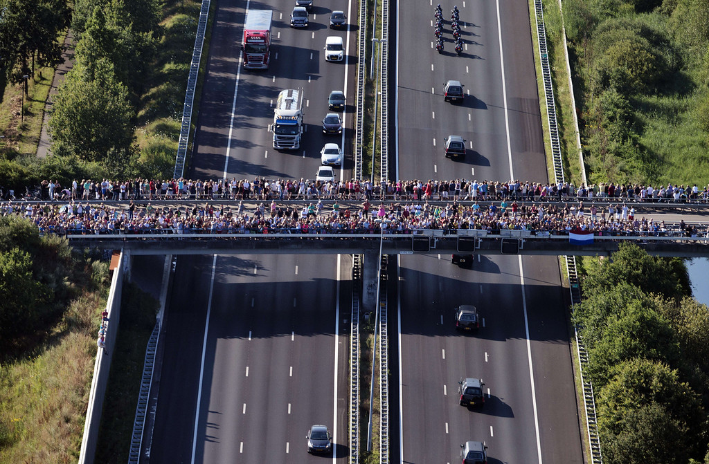 . An aerial view taken on July 23, 2014 shows people looking over a bridge the convoy of hearses carrying the bodies of victims of the downed Malaysia Airlines flight MH17 on their way to Hilversum where the bodies will be examined. The first bodies from flight MH17 arrived in the Netherlands on Wednesday almost a week after it was shot down over Ukraine, as the conflict flared yet again near the Malaysian airliner\'s crash site. AFP PHOTO/ANP/JERRY LAMPEN/AFP/Getty Images