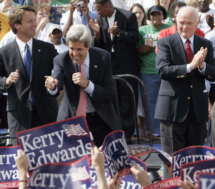 . Democratic Presidential candidate Sen. John Kerry, D-Mass., center, and his newly selected running mate Sen. John Edwards, D-NC, left, work the crowd after being introduced at a rally in Dayton, Ohio, Wednesday, July 7, 2004, by former Sen. John Glenn, D-Ohio, at right. (AP Photo/Al Behrman)