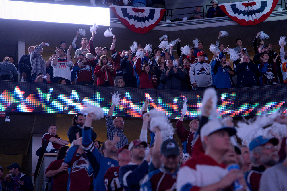 . Colorado Avalanche fans cheer their team on against the Minnesota Wild during the first quarter of action. The Colorado Avalanche hosted the Minnesota Wild for the first playoff game at the Pepsi Center on Thursday, April 17, 2014. (Photo by John Leyba/The Denver Post)