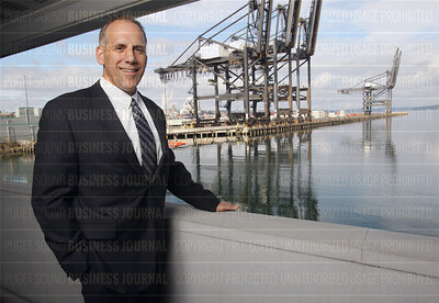 Port of Tacoma chief executive John Wolfe speaks about his port's powefulalliance with the Port of Seattle