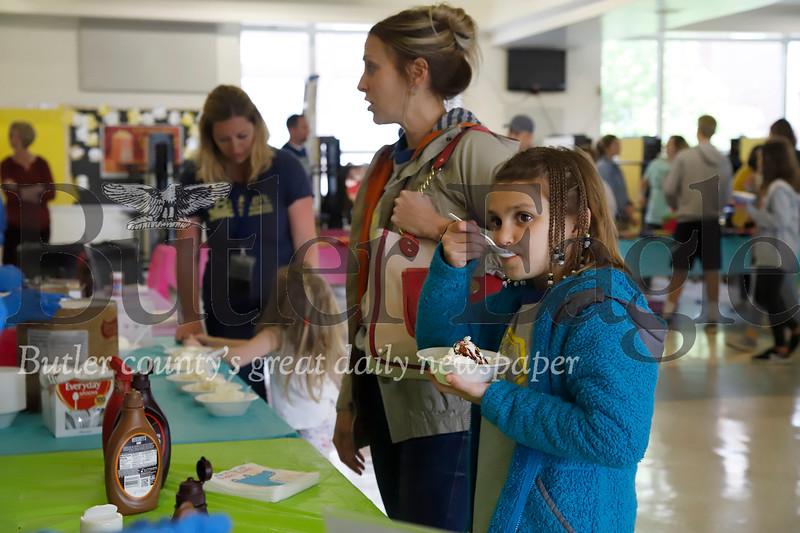Addison Geibel enjoys her custom made vanilla sundae at Tuesday evenings's Open Bowl fundraiser with her mom Kara Geibel. Seb Foltz/Butler Eagle
