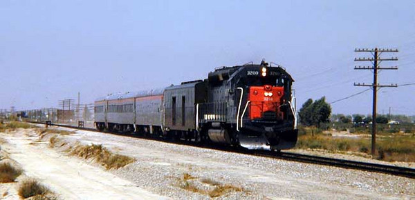 """SOUTHERN PACIFIC'S """"POKEY"""" #51/52  otherwise known as THE SAN JOAQUIN DAYLIGHT, in 1968.  Less then a year after this photo was taken, Ocklawaha declared this his private train. REASON? He was often the only one on it. Southern Pacific did it's best to run off the last passengers by not cleaning or maintaining it's cars, at the time an empty train was ground to discontinuance.  PHOTO: TRAINWEB  http://www.trainweb.org/theattic/SP5.jpg"""