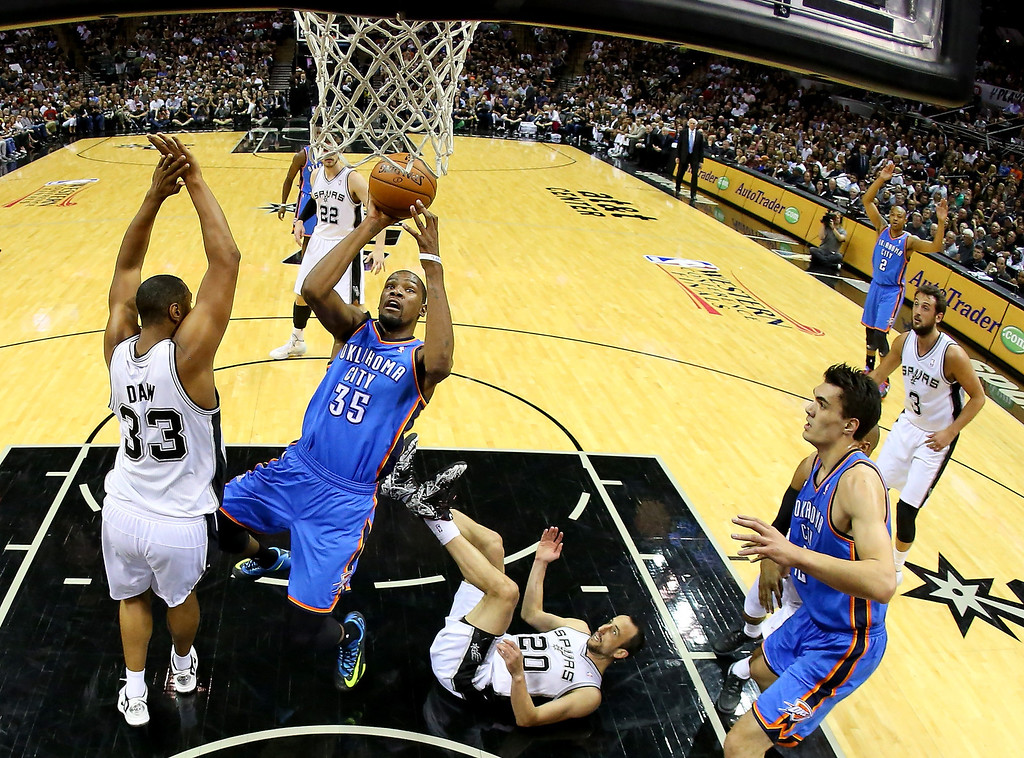 . Kevin Durant #35 of the Oklahoma City Thunder goes up for a shot against Boris Diaw #33 of the San Antonio Spurs in the first half in Game Two of the Western Conference Finals during the 2014 NBA Playoffs at AT&T Center on May 21, 2014 in San Antonio, Texas.  (Photo by Ronald Martinez/Getty Images)