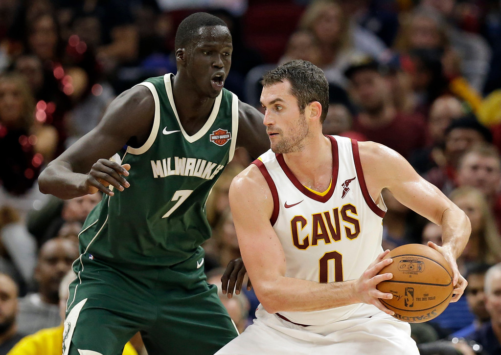 . Cleveland Cavaliers\' Kevin Love (0) drives against Milwaukee Bucks\' Thon Maker (7), from Australia, in the second half of an NBA basketball game, Tuesday, Nov. 7, 2017, in Cleveland. The Cavaliers won 124-119. (AP Photo/Tony Dejak)