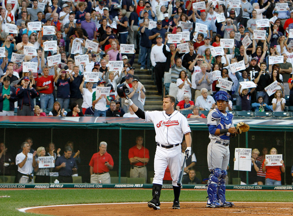 . Cleveland Indians\' Jim Thome tips his hat to fans as he comes to bat in the second inning of a baseball game against the Kansas City Royals, Friday, Aug. 26, 2011, in Cleveland. Thome was acquired from the Minnesota Twins in a waiver trade. Royals catcher Salvador Perez watches. (AP Photo/Mark Duncan)