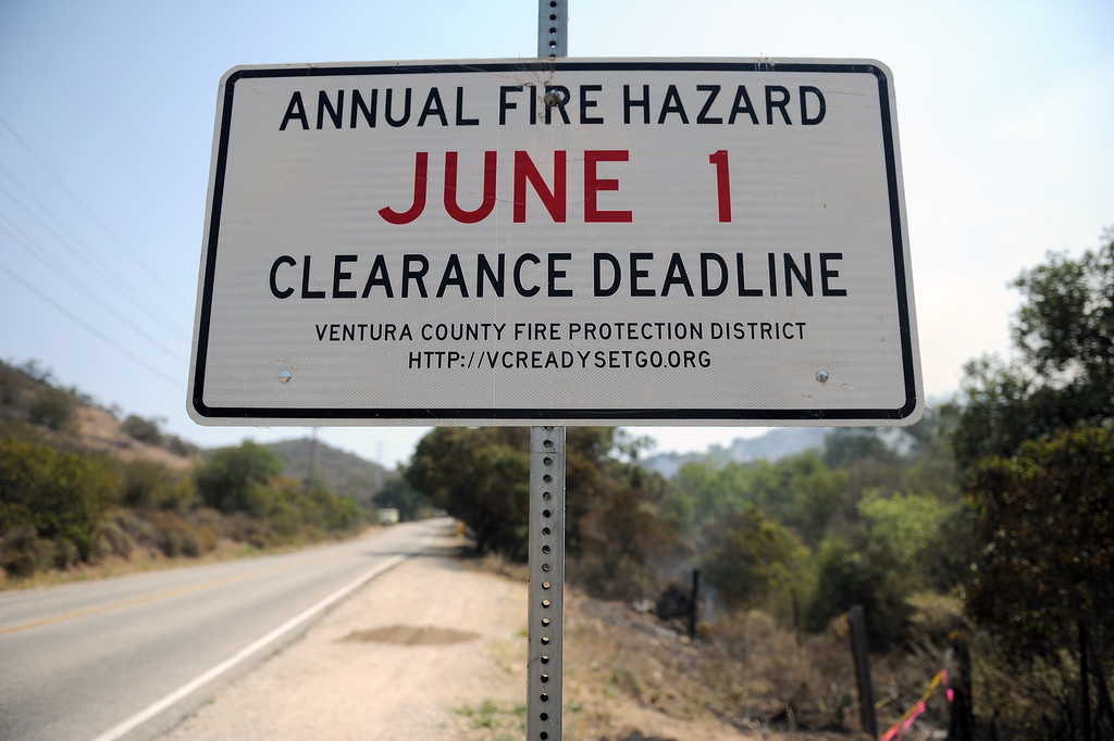 . A sign on Potrero Road in Newbury Park reminds residents of a brush clearance deadline, Saturday, May 4, 2013. (Michael Owen Baker/Staff Photographer)