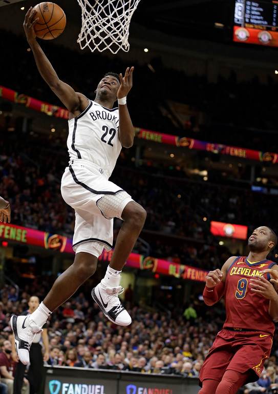 . Brooklyn Nets\' Caris LeVert (22) drives to the basket against Cleveland Cavaliers\' Dwyane Wade (9) during the first half of an NBA basketball game, Wednesday, Nov. 22, 2017, in Cleveland. (AP Photo/Tony Dejak)