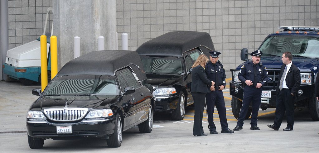 ". Family and dignitaries enter the service from the secluded loading dock at the HP Pavilion in San Jose, Calif., on Thursday, March 7, 2013. Thousands are at the pavilion to mourn the loss of  Santa Cruz police officers Loran ""Butch\"" Baker and Elizabeth Butler, who lost their their lives in the line of duty on Feb. 26. (Dan Honda/Bay Area News Group)"