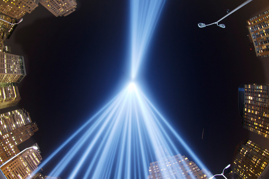 . In a photo made with a fisheye lens, the Tribute in Light rises above buildings in lower Manhattan, during a test, Tuesday, Sept. 10, 2013 in New York. The light display commemorates the twin towers of the World Trade Center that were destroyed in terrorist attacks 12 years ago on Sept. 11, 2001. (AP Photo/Mark Lennihan)