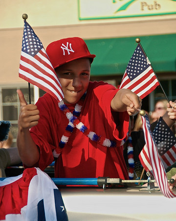 An All-American boy gives me the thumbs up as his float passed me during the 2010 Baldwinsville Memorial Day Parade on Sunday, May 30, 2010 in Baldwinsville, New York.