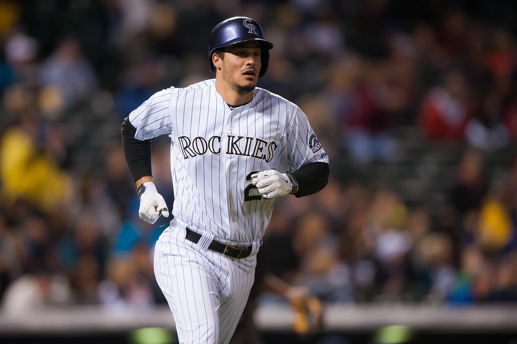 . DENVER, CO - SEPTEMBER 05:  Nolan Arenado #28 of the Colorado Rockies begins to run around the bases after hitting a sixth inning solo home run against the San Diego Padres during a game at Coors Field on September 5, 2014 in Denver, Colorado.  (Photo by Dustin Bradford/Getty Images)