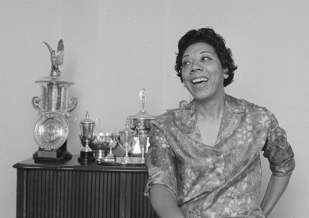 . Former tennis star Althea Gibson is seen in her East Orange, N.J. apartment during an interview, Dec. 21, 1968. (AP Photo/Marty Lederhandler)