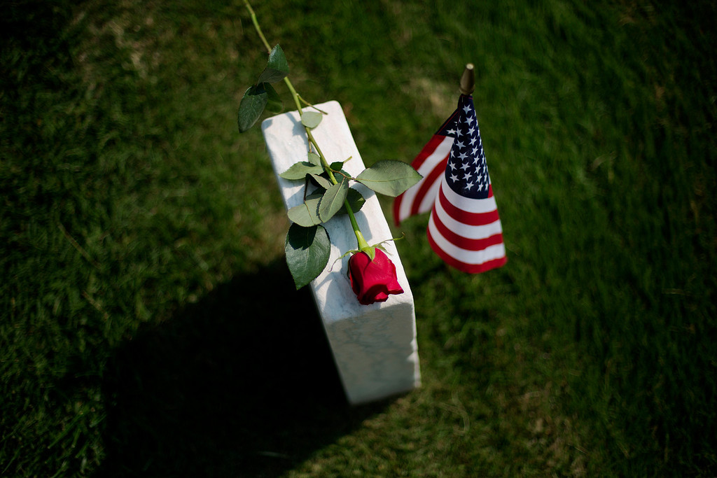 . A rose sits on a tombstone of a civl war soldier at Marietta National Cemetery on Memorial Day, Monday, May 26, 2014, in Marietta, Ga. (AP Photo/David Goldman)