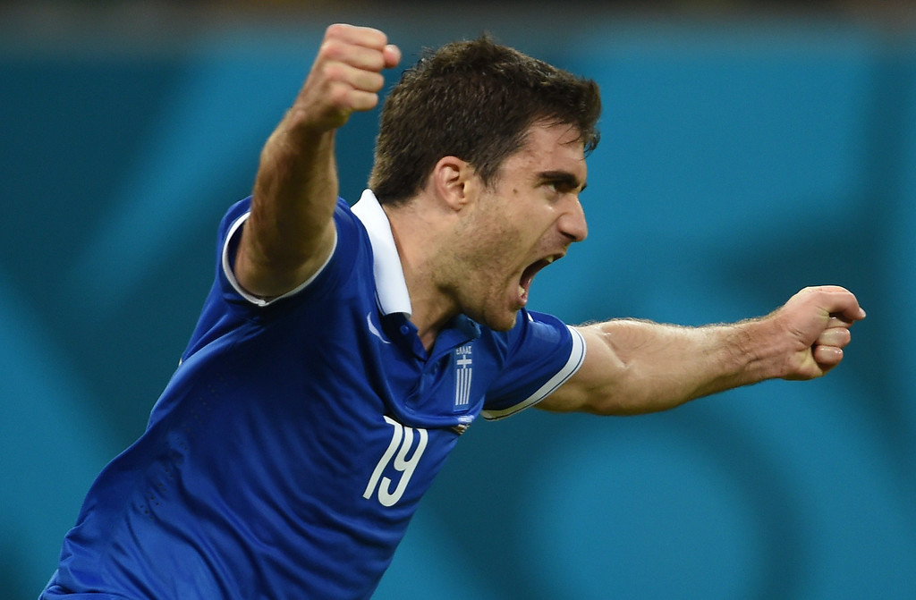 . Greece\'s defender Sokratis Papastathopoulos celebrates after scoring during a Round of 16 football match between Costa Rica and Greece at Pernambuco Arena in Recife during the 2014 FIFA World Cup on June 29, 2014.              PEDRO UGARTE/AFP/Getty Images